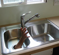 Garbage disposal with human hand reaching out of it