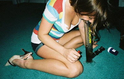 Girl smoking a marijuana bong