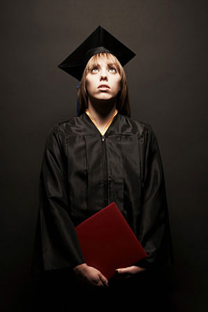 Girl in graduation gown, scared