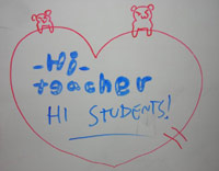 Whiteboard drawing from KC's students - 'HI TEACHER'