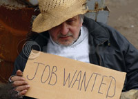 Homeless man holding 'Job Wanted' sign