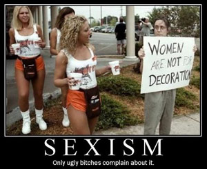 Hooters girls standing by a feminist with a sign