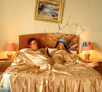 Frustrated couple in a hotel bed