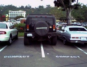 Hummer parked in a compact parking space