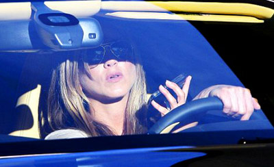 Jennifer Anniston texting while driving her car