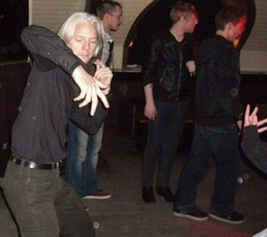 Julian Assange dancing at a bar