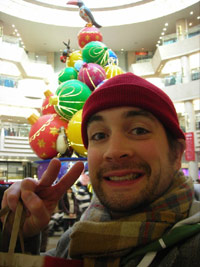 KC smiling in front of party balls