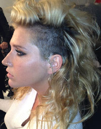Kesha with half-shaved, half-long hair