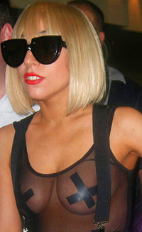 Lady Gaga with taped X's on her nipples