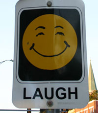 Laugh sign on the street with smiley face