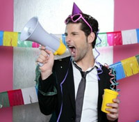 Guy with a party hat and megaphone