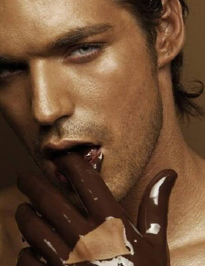 Hot guy with chocolate fingers