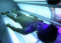 Man in a tanning bed