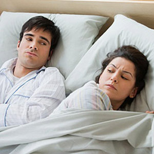 Man and woman in bed after sex