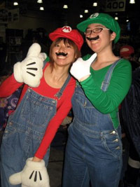 Girls dressed as Mario and Luigi characters