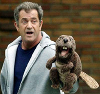 Mel Gibson with a beaver puppet on his hand