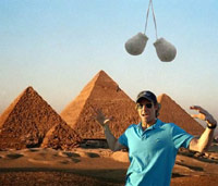Michael Bay in front of Egyptian pyramids with truck nuts hanging from above