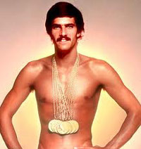 Michael Phelps wearing gold medals
