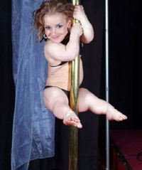 Midget stripper girl dancing on a pole