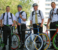 4 Mormons with helmets on fixie bicycles