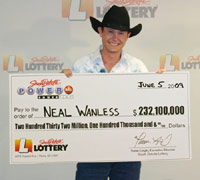 Neal Wanless, holding Powerball lottery check