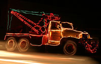 Party Tow Truck decorated with Christmas lights