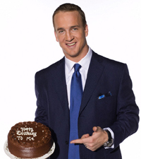 Peyton Manning holds his birthday cake