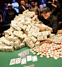 Poker pro with cash and chips on a poker table