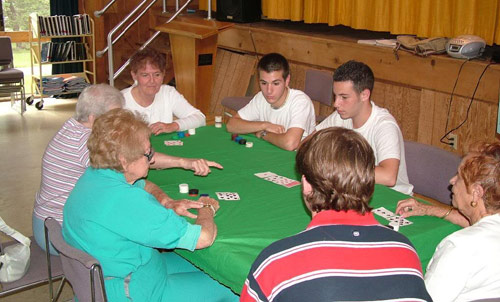 Poker room with old people and a couple of college students