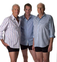 Three older men in boxers and button up shirts