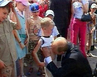 Putin kissing a 5-year-old's stomach