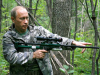 Putin carrying a tranquilizer gun.