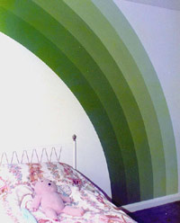 Pink bedroom with green rainbow