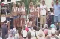 Grainy image of redneck town hall meeting outside