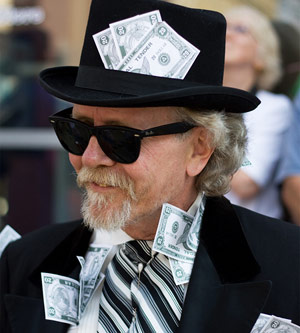 Rich man with a hat on with money in it