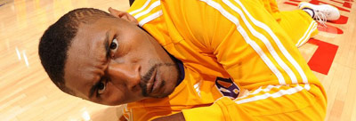 Ron Artest making a weird face while laying on an NBA floor