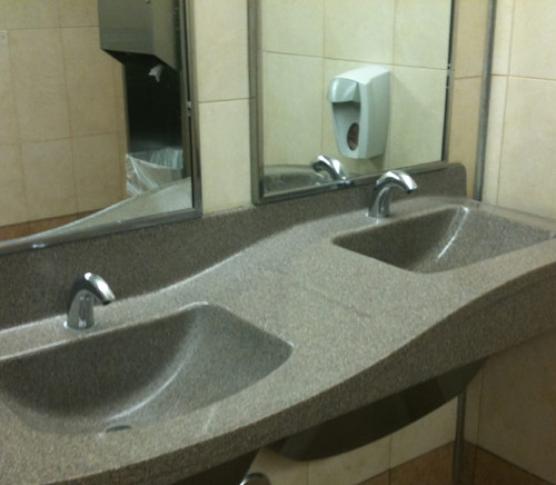 Sloping sink in a public restroom