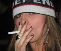 Slutty girl smoking a cigarette
