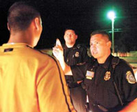 Police officer administering field sobriety finger test