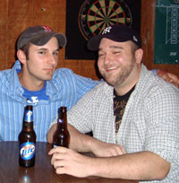 Two guys in a sports bar having beers