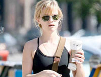 Reese Witherspoon drinking a Starbucks skinny latte