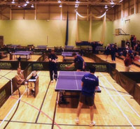 Table tennis club matches in a gym