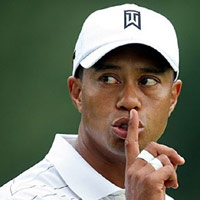 Tiger Woods with his finger to his mouth