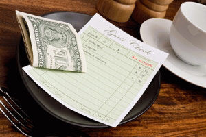 Server tip money on the table