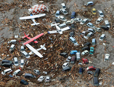 Tsunami trash includes cars, trucks and airplanes