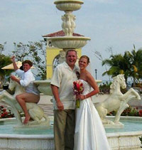 Guy acting stupid in a fountain behind a wedding picture