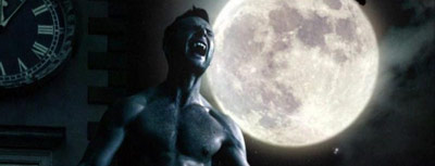 Man turning into a werewolf in front of a full moon
