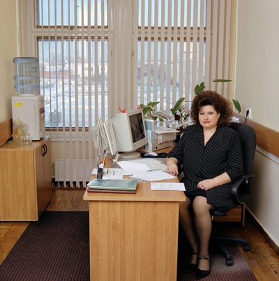 A woman sitting in her own office cubicle