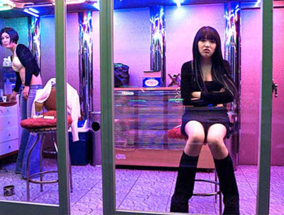 Asian girl in massage parlor window