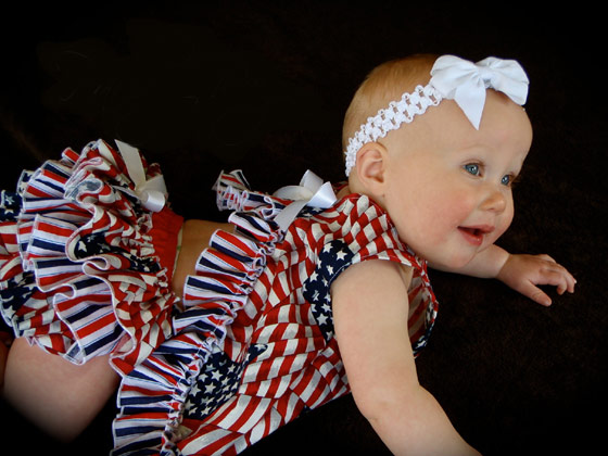 Baby wearing Fourth of July overalls